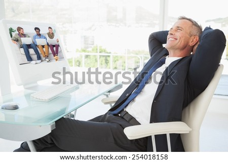 Male designers working together with laptops against relaxing businessman enjoy his day - stock photo