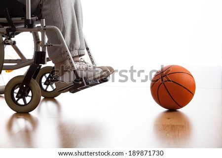 Male disabled athlete and ball on the floor - stock photo