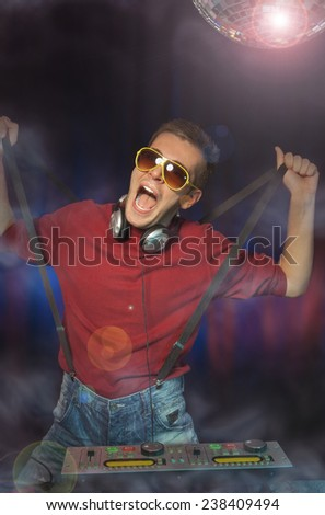 Male DJ playing with his suspenders. - stock photo