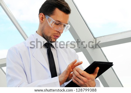 male doctor holding a tablet computer