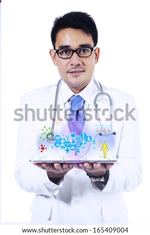 Male doctor holding tablet pc with medical app. Isolated on white background - stock photo