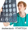 male doctor looking at tomography brain - stock photo
