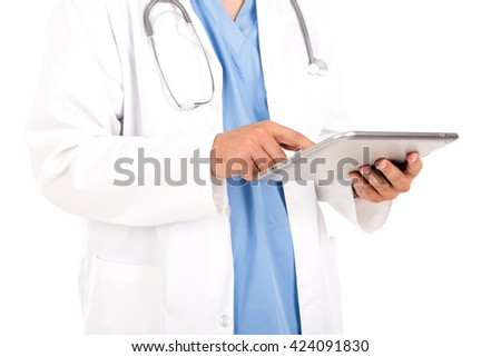 Male doctor's hands working with a tablet - stock photo