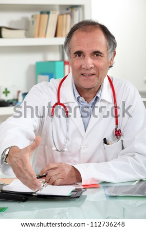 Male doctor sat in office
