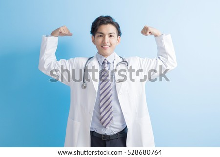 male doctor show strong arm to you, asian