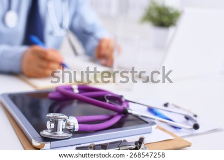 Male doctor sitting at his desk