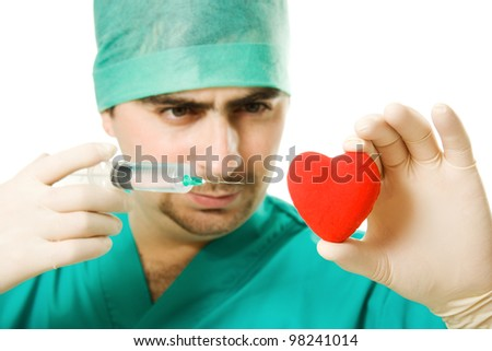 Male doctor with a heart and a syringe in his hand on a white background. - stock photo