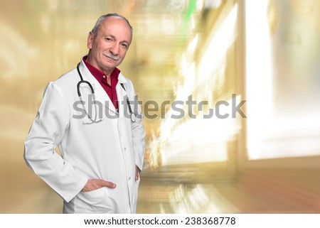 Male doctor with stethoscope - stock photo
