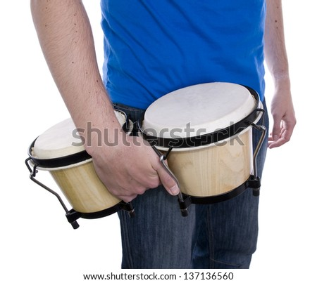 male drummer standing against white background, holding bongos by his side - stock photo