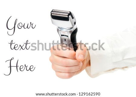 Male electric shaver in hands fist - stock photo