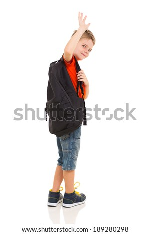 male elementary school student waving goodbye isolated on white background - stock photo
