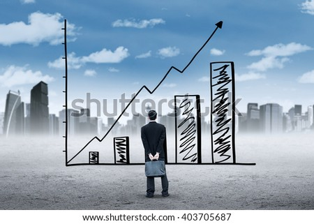 Male employee holding a briefcase and look at a growing chart with upward arrow