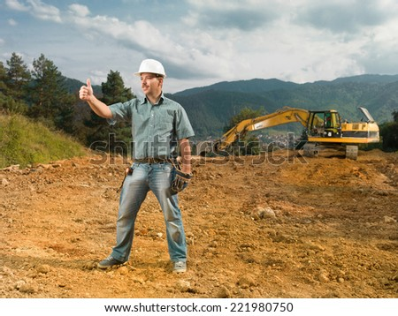 male engineer showing ok sign on construction site