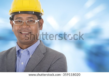 male engineer wear yellow helmet with colorful background - stock photo
