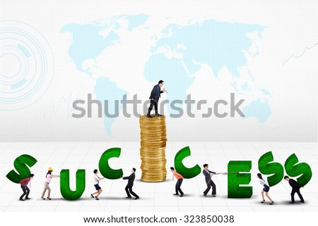 Male entrepreneur giving orders on his team to create a success text - stock photo