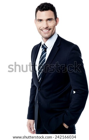 Male entrepreneur posing with his hands in pocket - stock photo
