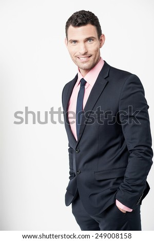 Male entrepreneur standing with his hands in pockets - stock photo