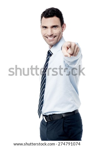 Male executive pointing his finger towards camera - stock photo