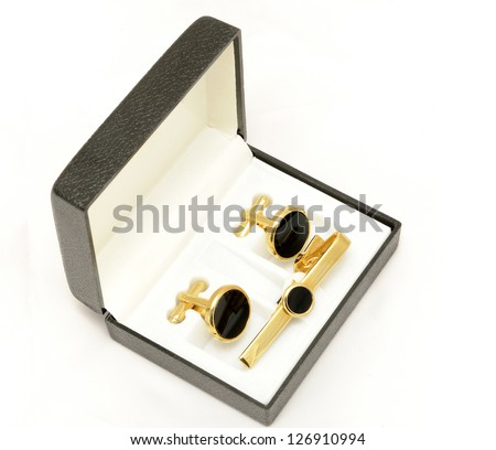 male fashion accessories: black box with cufflinks and tie pin - stock photo