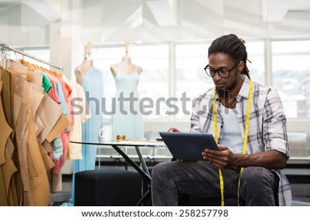 Male fashion designer using digital tablet