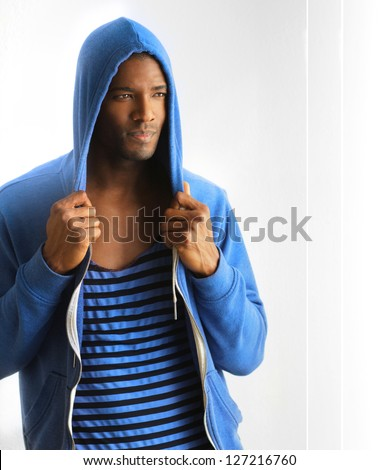 Male fashion model posing in active wear clothing against modern white background with copyspace - stock photo