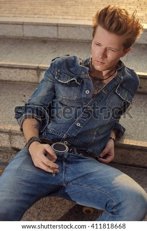 Male fashion shoot witth young models in denim style att the city - stock photo