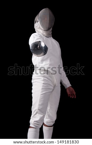 Male fencer isolated in a dark background - stock photo