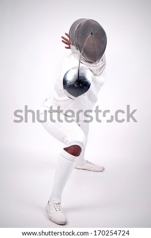 Male fencer isolated in a light background - stock photo