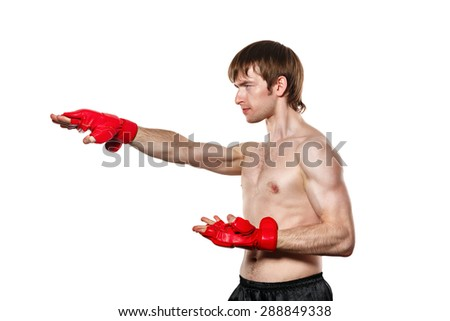 Male fighter kung fu strike directly. Isolated on white background. The concept of martial arts. - stock photo