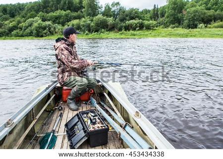 male fisherman boat - stock photo