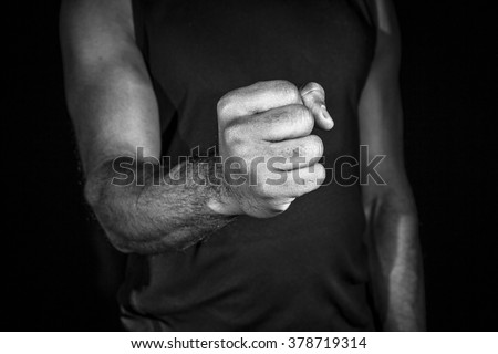 Male fist in black and white. - stock photo