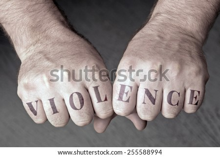 "Male fist with the word ""violence"" - stock photo"