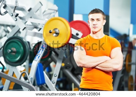 male fitness trainer at gym