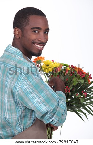 Male florist with a bunch of flowers - stock photo
