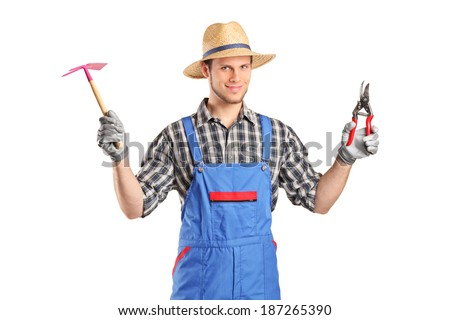 Male gardener holding working tools isolated on white background - stock photo