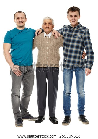 Male generations - grandfather, son and grandson in full length studio portrait - stock photo