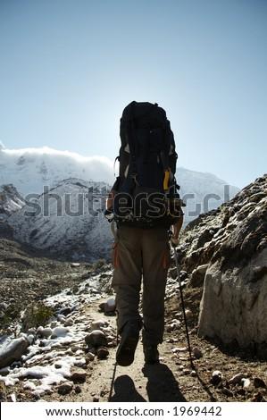 Male going along trail in the Cordillera mountain - stock photo