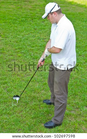 Male golf player - stock photo