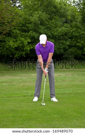 Male golfer playing a mid iron shot from the edge of the fairway, series of four images from addressing the ball to the follow through. - stock photo