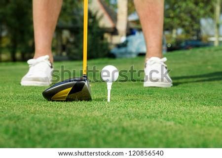 Male golfer ready to shot a golf ball - stock photo