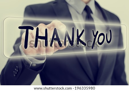 Male hand activating a Thank you button on virtual screen. With a vintage instagram style filter effect. - stock photo