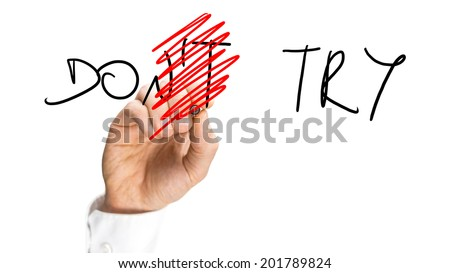 Male hand changing sign don't try into Do try on virtual screen. - stock photo