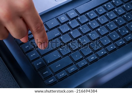 Male Hand Clicking Cyrillic Notebook Keyboard