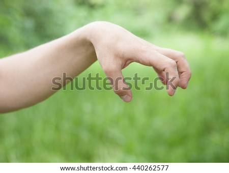 Male hand demonstrating a sign of an aggression, closeup shot