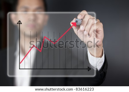 Male hand drawing a chart
