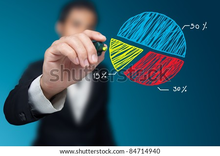 Male hand drawing a chart. - stock photo