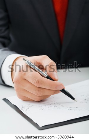 Male hand drawing a scheme of  business process on the paper
