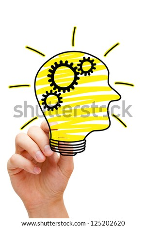 Male hand drawing human head in the shape of a light bulb on transparent wipe board. - stock photo