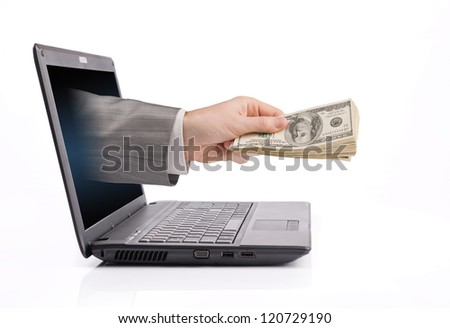Male hand from laptop screen giving money - stock photo