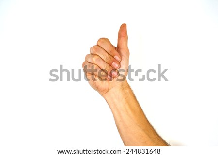 Male hand giving a thumbs up gesture of approval and success with the bent fingers and palm towards the camera and arm raised, isolated on white - stock photo